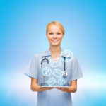 healthcare, medicine, people and technology concept - smiling female doctor or nurse with tablet pc computer
